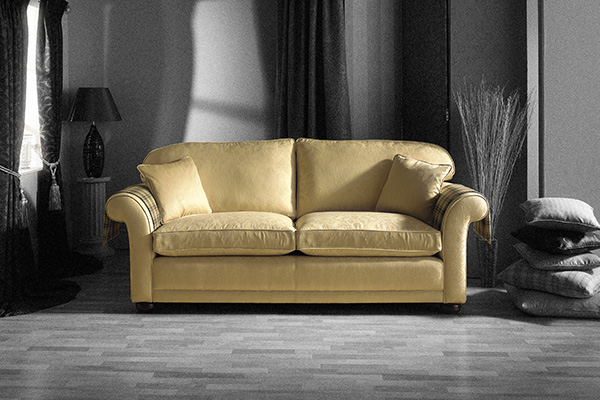 gold sofa in black and white room