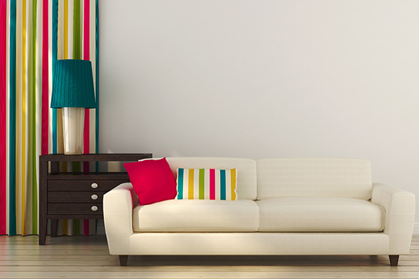 White sofa with colorful decor